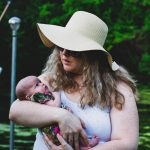 woman-carrying-her-baby-